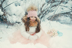 Snowy Winter And A Girl In A Cap Royalty Free Stock Photos
