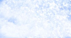 Snowy winter background. Pure snow sparkles and sparkles, blue hue. Background for design stock photo