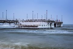 Frozen pier at Baltic Sea in Gdansk. Snowy winter at Baltic Sea in Gdansk, Poland Royalty Free Stock Photos