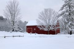 Snowy Winter Barn In New England. A red new England Barn on a snowy day in winter stock image