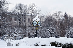 Snowy winter, Bucharest, Romania: the clock in Cismigiu Gardens Royalty Free Stock Photos