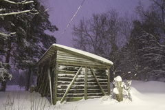 A snowy winter cabin scene Stock Photo