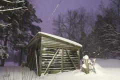 A snowy winter cabin scene Stock Photo