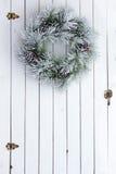 Snowy winter Christmas wreath on a barn door Stock Photos