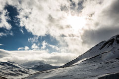 Snowy winter cloud scene in Scandinavia royalty free stock photography