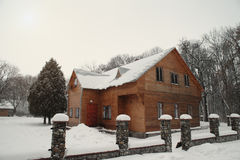 Snowy winter house Stock Images