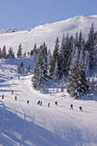Snowy winter landscape. With skiers on Jahorina mountain near Sarajevo, Republika Srpska, Bosnia Royalty Free Stock Photos