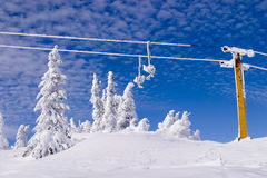 Snowy winter landscape. With ski lift and blue sky background on Jahorina mountain near Sarajevo, Republika Srpska, Bosnia Royalty Free Stock Images