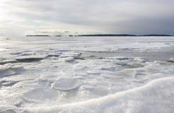Snowy winter landscape at frozen sea Royalty Free Stock Photo