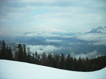 Snowy winter landscape in a mountain ski resort on a foggy day Stock Photos
