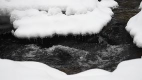 Snowy Winter Landscape with River in Forest. Flowing Water and Breaking Ice. Slow Motion stock video