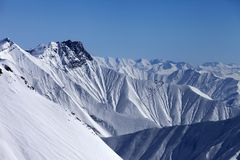 Snowy winter mountains in haze Royalty Free Stock Photo