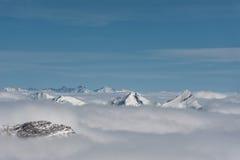 Snowy winter mountains in sun day. Georgia, from ski resort Gudauri. Stock Image