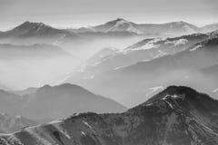 Snowy winter mountains in sun day. Georgia, from ski resort Gudauri. Stock Photos
