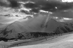 Snowy winter mountains in sun day. Georgia, from ski resort Gudauri. Royalty Free Stock Image