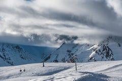Snowy winter mountains in sun day. Georgia, from ski resort Gudauri. Royalty Free Stock Photography