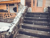 Snowy winter noon. Snow covered stairs of small cafe. Mountain ski resort Bakuriani.  stock photos