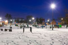 Snowy winter in the park at dusk. Snowy winter at the playground at dusk, Poland Stock Photos