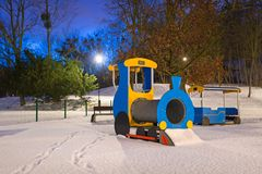 Snowy winter in the park at dusk. Snowy winter at the playground at dusk, Poland Stock Photography
