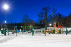 Snowy winter in the park at dusk. Snowy winter at the playground at dusk, Poland Stock Images