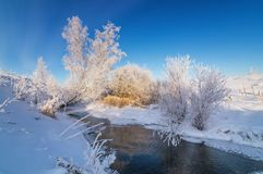 Snowy winter ravine with bushes on the Creek Bank, Russia, the Urals, Stock Photos