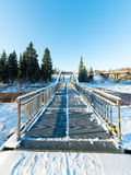 Snowy winter river landscape with metal bridge Stock Image