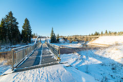 Snowy winter river landscape with metal bridge Stock Photo