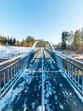 Snowy winter river landscape with metal bridge Stock Photo