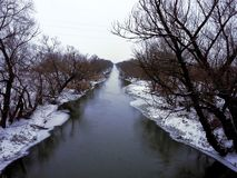 Snowy winter river landscape in Serbia royalty free stock photos