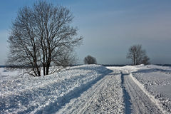Snowy winter road Royalty Free Stock Image