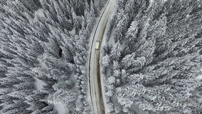 Snowy Winter Road with a Car Royalty Free Stock Image