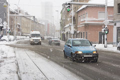 Snowy winter road with cars driving Stock Photos