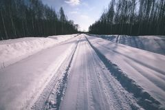 snowy winter road covered in deep snow - vintage look edit Stock Images