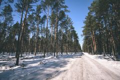 snowy winter road covered in deep snow - vintage look edit Royalty Free Stock Photos