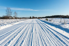 Snowy winter road with tire markings Stock Photos