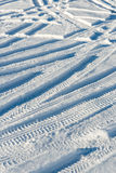 Snowy winter road with tire markings Stock Photography
