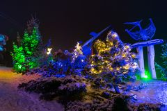 Snowy winter scene and christmas light decorations Stock Photography