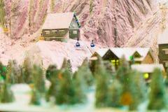 Snowy winter scene of a small hamlet model Royalty Free Stock Photo