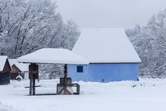 Snowy winter scene in the Village Museum royalty free stock photo