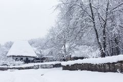 Snowy winter scene in the Village Museum royalty free stock images