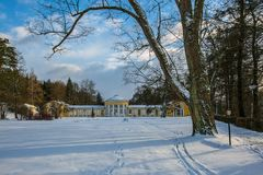 Snowy winter scene of yellow building of Ferdinand colonnade at Marienbad. Snowy winter scene of yellow building of Ferdinand colonnade with mineral water at spa royalty free stock photography