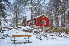 Snowy winter scenery with red wooden house. In the forest, Sweden Stock Images