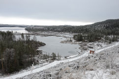 Snowy winter in Sweden. With frozen river and snow covered nature Stock Images