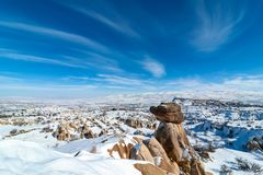 Snowy winter time at three Graces, three Beautifuls uc guzeller rock hills in Devrent valley Cappadocia, Nevsehir, Turkey. stock image