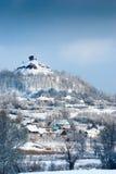 Snowy winter village. Near the slagheap Royalty Free Stock Image