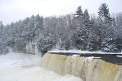 Snowy Winter Waterfall. A waterfall partially frozen in the wintertime Stock Photography