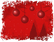 Snowy winter wonderland/red. Winter holiday background with snow and Christmas balls Stock Image