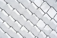 Snowy wire netting. Detail of the wire netting in winter Stock Photography