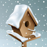 Snowy wood birdhouse Stock Images