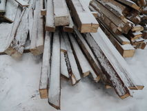 Snowy wood stapled Royalty Free Stock Photo